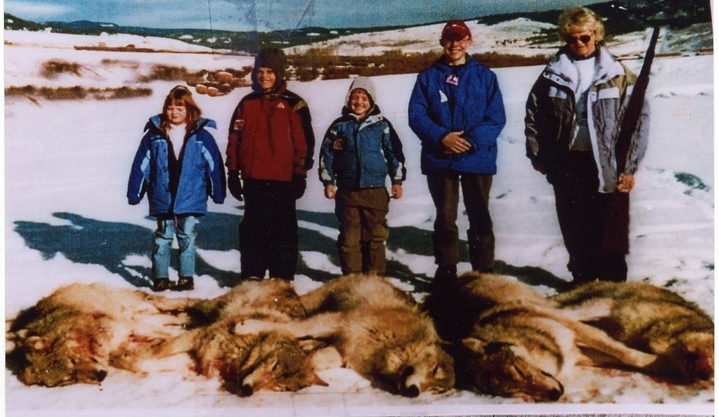School Children Stand Beside Wolves Killed via Arial Gunning by Wildlife Services